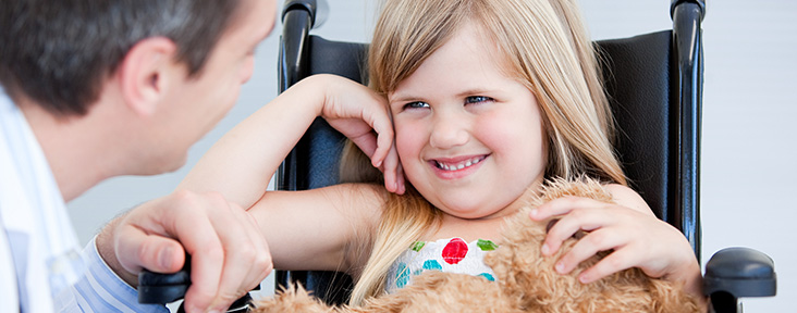 Smiling Girl Sitting in a Wheelchair